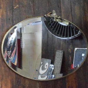 Oval Art Deco Mirror with Brass trim and Crest Detail