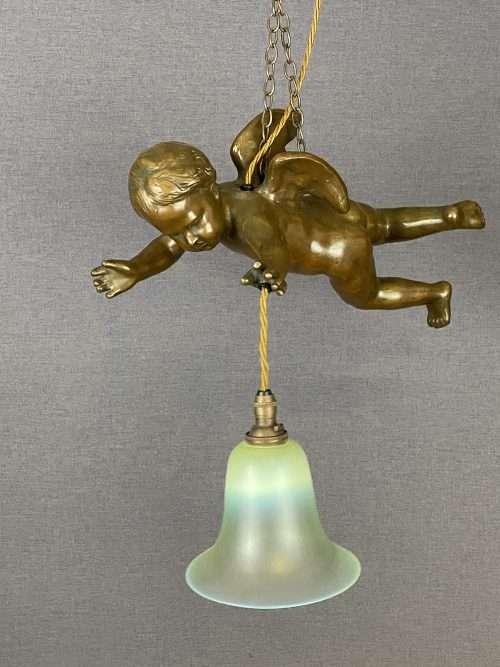 brass cherub light